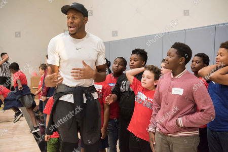 Golden State Warriors' Andre Iguodala kicks off the Kids Foot Locker Fitness Challenge, encouraging Club kids to stay active and fit, at the Boys & Girls Clubs of San Francisco
