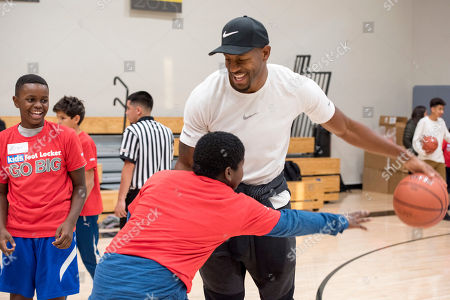 Stock Picture of Golden State Warriors' Andre Iguodala kicks off the Kids Foot Locker Fitness Challenge, encouraging Club kids to stay active and fit, at the Boys & Girls Clubs of San Francisco