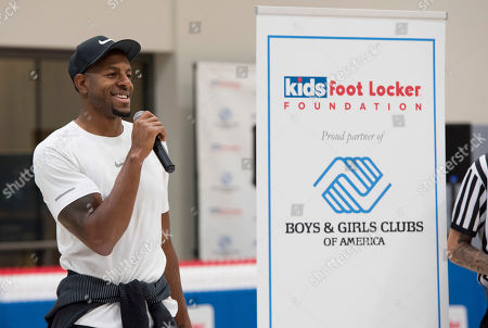 Stock Photo of Golden State Warriors' Andre Iguodala kicks off the Kids Foot Locker Fitness Challenge, encouraging Club kids to stay active and fit, at the Boys & Girls Clubs of San Francisco