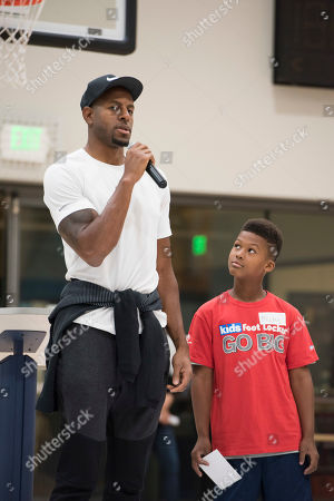 Golden State Warriors' Andre Iguodala answers questions from Club kid Mickey Williams during the Kids Foot Locker Fitness Challenge kick off event at the Boys & Girls Clubs of San Francisco