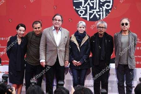 (L-R) Busan International Film Festival (BIFF) festival director Kang Soo-Youn, Iranian director Bahman Ghobadi, US director Oliver Stone, French director Agnes Godard, Filipino filmmaker Lavrente Diaz and South Korean director Jang Sun-Woo, pose for photographers after a press conference of the New Currents Jury the 22th Busan International Film Festival (BIFF) in Busan, South Korea, 13 October 2017. The BIFF runs from 12 to 21 October 2017, with 298 films from 75 countries to be screened.