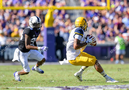 Stock Photo of West Virginia Mountaineers wide receiver Marcus Simms (8) catches a pass as TCU Horned Frogs cornerback Tony James (28) defends during an NCAA Football game between West Virginia Mountaineers and the TCU Horn Frogs at Amon Carter Stadium in Fort Worth, Texas