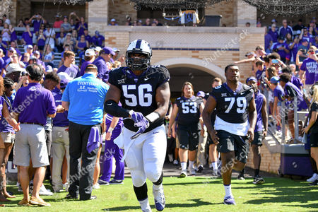 Stock Photo of TCU players and  TCU Horned Frogs defensive tackle Chris Bradley (56) introduced during an NCAA Football game between West Virginia Mountaineers and the TCU Horn Frogs at Amon Carter Stadium in Fort Worth, Texas