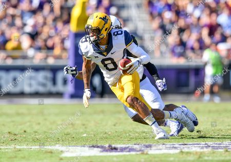 West Virginia Mountaineers wide receiver Marcus Simms (8) catches a pass as TCU Horned Frogs cornerback Tony James (28) defends during an NCAA Football game between West Virginia Mountaineers and the TCU Horn Frogs at Amon Carter Stadium in Fort Worth, Texas