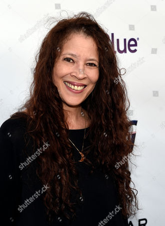 Stock Picture of Figure skater Tai Babilonia poses at the five-year anniversary of the non-profit advocacy organization Tie The Knot supporting LGBTQ equality, at NeueHouse Hollywood, in Los Angeles