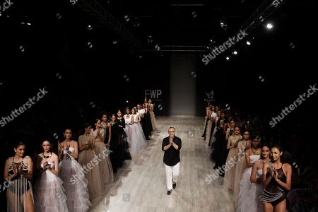 Models wear creations by Mexico's jewelry designer Daniel Espinosa, center, during Panama Fashion Week in Panama City