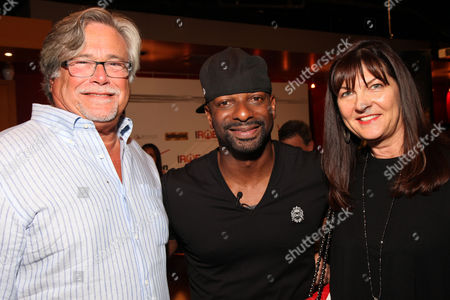 Miami Heat managing general partner Micky Arison and wife Madeleine pose with DJ Irie during the 9th Annual Irie Weekend Celebrity Bowling Tournament on Saturday, June, 29, 2013 at Lucky Strike Lanes in Miami Beach, Fl