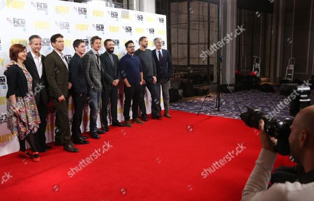 From left, festival director Clare Stewart, producer Bill Block, actors Jon Bernthal, Logan Lerman, Brad Pitt, Shia LeBeouf and Michael Pena, director David Ayer and producer John Lesher pose for photographers at the photo call for the film Fury, which closes the BFI London Film Festival, at the Corinthia hotel in central London