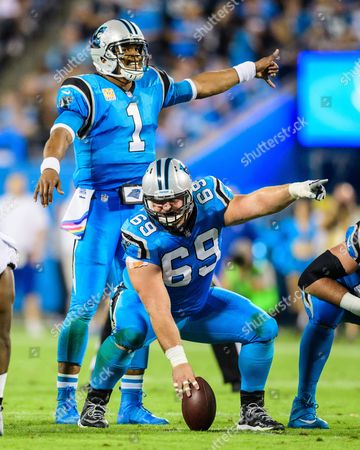 Carolina Panthers quarterback Cam Newton (1) and Carolina Panthers center Tyler Larsen (69) during the NFL football game between the Philadelphia Eagles and the Carolina Panthers on in Charlotte, NC