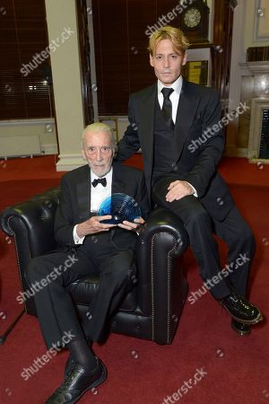 British actor Sir Christopher Lee receives the BFI Fellowship award from American actor Johnny Depp at he 57th BFI London Film Festival Awards Night at Banqueting House Whitehall,, in London