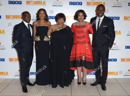 From left to right, Tony Kgoroge, Naomie Harris, Zindzi Mandela, her sister Zenani, and Idris Elba pose for photographers at the UK Premiere of 'Mandela: Long Walk To Freedom' at the Odeon Leicester Square in London on