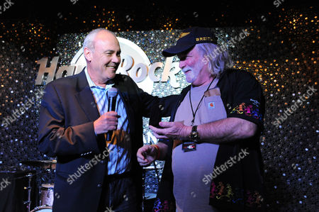 Hamish Dodds, left, President and CEO of Hard Rock International, presents Gregg Morton, Hard Rock Rewards member, with an exclusive Hard Rock pin to commemorate his 200th Hard Rock Cafe visit at the Grand Opening of the new Hard Rock Cafe New Orleans, in New Orleans