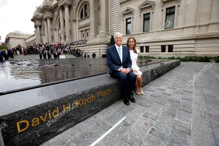 "David H. Koch, left, and Julia Koch as seen at the unveiling of the Metropolitan Museum of Art's new ""David H. Koch Plaza,"" on Tues., in New York"