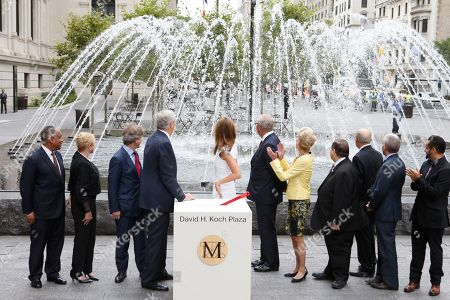 "From left, Mitchell Silver,Carolyn Maloney, Thomas P. Campbell, David H. Koch, Julia Koch, Daniel Brodsky, Emily K. Rafferty, Jerrold Nadler, Tom Finkelpearl, Jimmy Van Bramer and Jose M. Serrano as seen at the unveiling of the Metropolitan Museum of Art's new ""David H. Koch Plaza,"" on Tues., in New York"