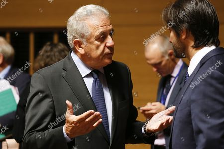 EU Commissioner for Migration, Home Affairs and Citizenship, Dimitris Avramopoulos (L) chats with Slovak Interior Minister Robert Kalinak (R) at the start of the Joint Justice and Home Affairs Council meeting in Luxembourg, 13 October 2017. There will be a Proposal for a regulation amending the Schengen Borders code.