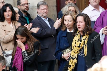 French actor Jean Rochefort's widow Francoise Vidal, center right, and two of his daughters Clemence, left, and Louise, right, leave after the funeral ceremony for French actor Jean Rochefort at the Saint Thomas d'Aquin church in Paris, . French actor Jean Rochefort, who starred in more than 100 movies over a half-century and was much loved by the French public, has died. He was 87