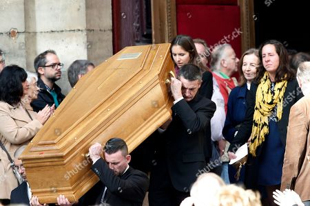 Pallbearers carry the coffin of late French actor Jean Rochefort, followed by his widow Francoise Vidal, second from right, and two of his daughters Clemence, center, and Louise, right, during the funeral ceremony at the Saint Thomas d'Aquin church in Paris, . French actor Jean Rochefort, who starred in more than 100 movies over a half-century and was much loved by the French public, has died. He was 87