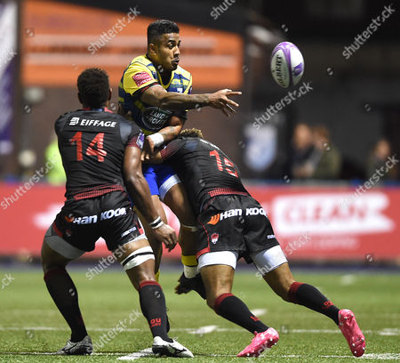 Stock Photo of Rey Lee-Lo of Cardiff Blues is tackled by Delon Armitage of Lyon.