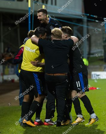 A Rangers fan joins in the celebrations with the Rangers players after Carlos Pena scored to give them a 0-2 lead