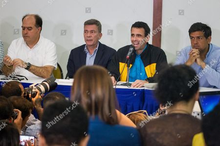 The president of the National Assembly of Venezuela Julio Borges (L), the campaign chief of the Democratic Unity Bureau (MUD), Gerardo Blyde (2-L), Miranda state outgoing governor Henrique Capriles (2-R), and Miranda state gubernatorial candidate Carlos Ocariz (R), take part in a press conference in Caracas, Venezuela, 13 October 2017. Venezuelan opposition denounced today that the relocation of near 300 polling stations less than 72 hours of the regional elections of Sunday mainly affects fiefs of the parties against the Government and is a maneuver to subtract votes for the opposition parties. Venezuela is holding regional elections on 15 October.