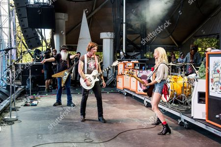 Dave Catching, Jesse Hughes, Jennie Vee. Dave Catching, from left, Jesse Hughes and Jennie Vee of Eagles of Death Metal perform at the Austin City Limits Music Festival at Zilker Park, in Austin, Texas
