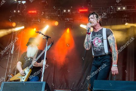 Dave Catching, Jesse Hughes. Dave Catching, left, and Jesse Hughes of Eagles of Death Metal perform at the Austin City Limits Music Festival at Zilker Park, in Austin, Texas