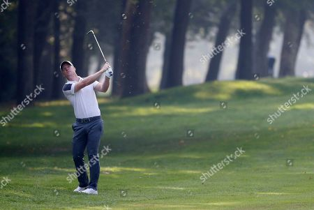 Stock Image of David Horsey, of Britain, hits the ball during the 74th Italy Open Golf tournament in Monza, Italy