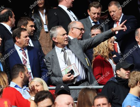Premier League executive chairman Richard Scudamore looks on from the stand
