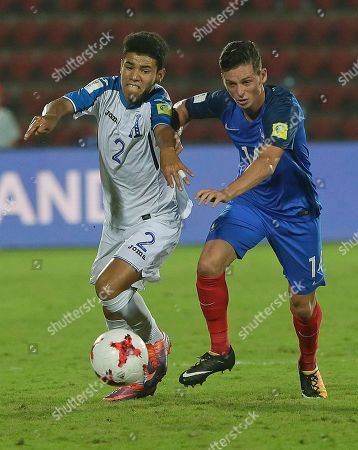 France's Alexis Flips, right, and Honduras' Santiago Cabrera vie for the ball during their FIFA U-17 World Cup match in Gauhati, India
