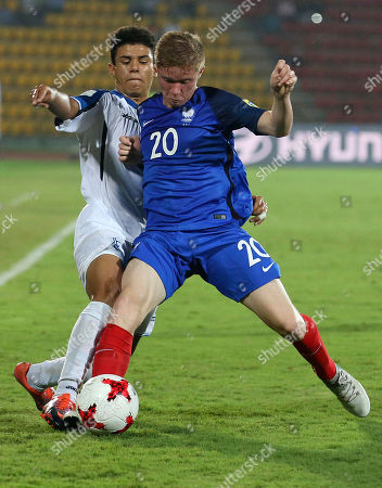 France's Melvin Bard, front, and Honduras' Santiago Cabrera fight for control of the ball during their FIFA U-17 World Cup match in Gauhati, India, Saturday, Oct.14, 2017