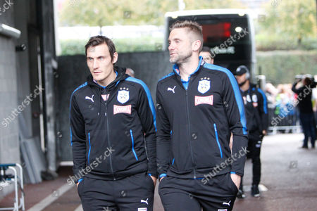 Robert Green and Dean Whitehead of Huddersfield Townarrives at the stadium, ahead of the Premier League match between Swansea City and Huddersfield Town at the Liberty Stadium, Swansea