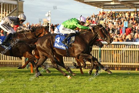 EARTHA KITT (green) ridden by Richard Kingscote beating Pixeleen (yellow red) & Queen Kindly (right) in The Darley EBF Stallions Boadicea Stakes (Listed) at Newmarket