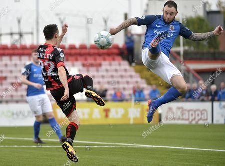 Crusaders vs Glenavon. Crusaders Paul Heatley in action with Glenavons Andrew Doyle