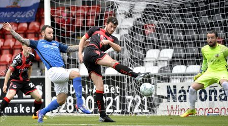 Crusaders vs Glenavon. Crusaders Philip Lowry in action with Glenavons Andrew Doyle