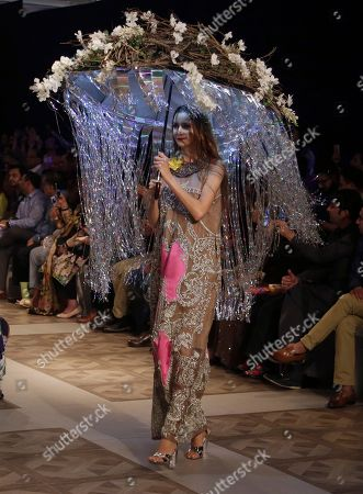 A model presents a creation by designer Ali Xeeshan during the Bridal Fashion Week in Lahore, Pakistan, . More than twenty five designers showcasing their latest bridal collections in the three-day event organized by the Pakistan Fashion Design Council