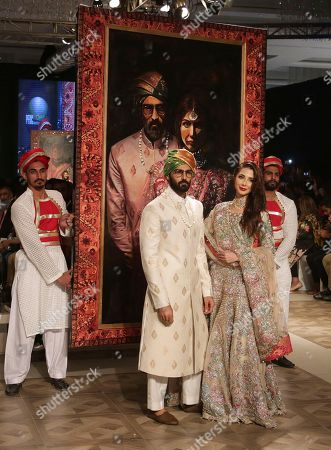 Models present creations by designer Ali Xeeshan during the Bridal Fashion Week in Lahore, Pakistan, . More than twenty five designers showcased their latest bridal collections in the three-day event organized by the Pakistan Fashion Design Council