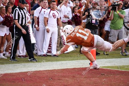 Stock Image of Texas Longhorns quarterback Sam Ehlinger (11) dives in the endzone during the Red River Showdown NCAA Football game between the University of Oklahoma Sooners and the University of Texas Longhorns at the Cotton Bowl Stadium in Dallas, TX Michael Dorn/CSM