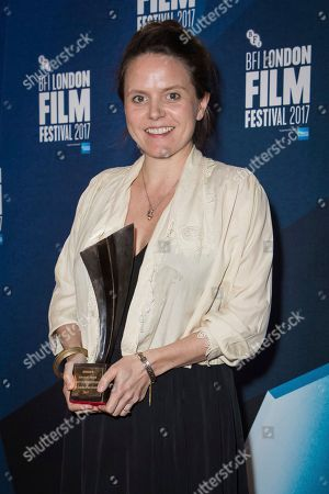 Documentary competition winner Lucy Cohen poses for photographers after receiving the Grieson award for her film 'Kingdom of Us' at the London Film Festival Awards in London