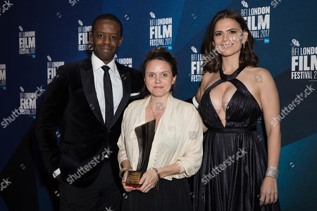 Adrien Lester, Lucy Cohen, Hayley Atwell. Documentary competition winner Lucy Cohen, centre, holds her Grieson award for her film 'Kingdom of Us' as she poses with actors Adrien Lester, left, and Hayley Atwell at the London Film Festival Awards in London