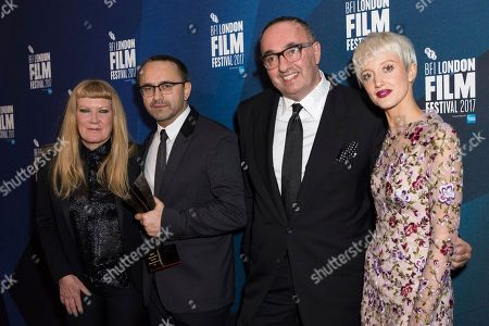 Andrey Zvyagintsev, Alexander Rodnyansky, Andrea Arnold, Andrea Riseborough. Directors Andrey Zvyagintsev, second left and Alexander Rodnyansky, second right, pose for photographers along with director Andrea Arnold, left, and actress Andrea Riseborough, right, after they received the Official Competition Best Film award for their film 'Loveless' at the London Film Festival Awards in London