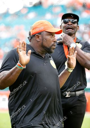 Michael Irvin, Warren Sapp. Warren Sapp, left, and Michael Irvin react during a ring of honor ceremony at the halftime an NCAA College football game between Miami and Georgia Tech, in Miami Gardens, Fla. Irvin, Sapp, Ed Reed, Ray Lewis and Sean Taylor were inducted into Miami's ring of honor. Irvin (2007) and Sapp (2013) got in the Pro Football Hall of Fame before they made their school's ring of honor