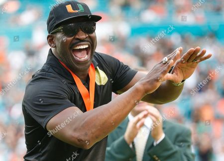 Michael Irvin reacts during a ring of honor ceremony at halftime of an NCAA college football game between Miami and Georgia Tech, in Miami Gardens, Fla. Irvin, Warren Sapp, Ed Reed, Ray Lewis and Sean Taylor were inducted into Miami's ring of honor. Irvin (2007) and Sapp (2013) got in the Pro Football Hall of Fame before they made their school's ring of honor