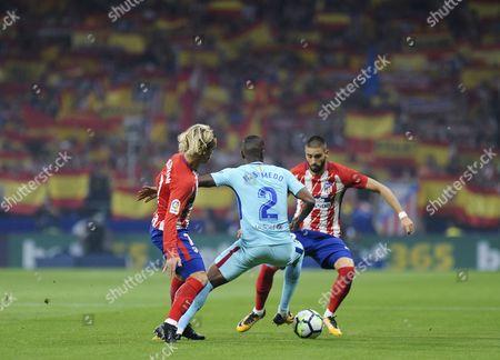 Atletico Madrid's forward from France Antoine Griezmann; Barcelona's Portuguese defender  Nelson Semedo; Atletico Madrid's midfielder from Belgium Yannick Ferreira Carrasco