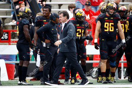 Under Armour CEO Kevin Plank walks on the Maryland sideline before an NCAA college football game between Maryland and Northwestern in College Park, Md
