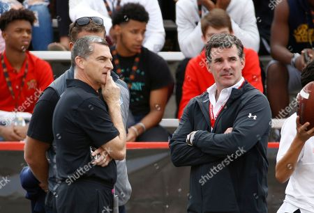 Kevin Plank, Mark Turgeon. Under Armour CEO Kevin Plank, right, stands on the Maryland sideline alongside Maryland basketball head coach Mark Turgeon during an NCAA college football game between Maryland and Northwestern in College Park, Md