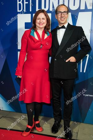 Clare Stewart, left, poses for photographers upon arrival at the London Film Festival Awards in London