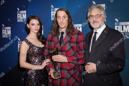 Stock Image of Patrick Bresnan, Anya Taylor-Joy, Michael Dudok. Director Patrick Bresnan poses for photographers along with Anya Taylor-Joy and Michael Dudok de Wit after he received the Best Short Film award for his film 'The Rabbit Hunt' at the London Film Festival Awards in London