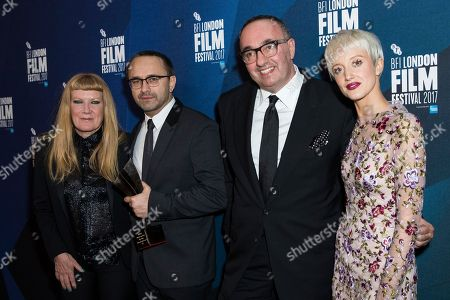 Andrey Zvyagintsev, Alexander Rodnyansky, Andrea Arnold, Andrea Riseborough. Directors Andrey Zvyagintsev, second left and Alexander Rodnyansky, second right, pose for photographers along with Andrea Arnold, left, and Andrea Riseborough, right, after receiving the Official Competition Best Film award for their film 'Loveless' at the London Film Festival Awards in London