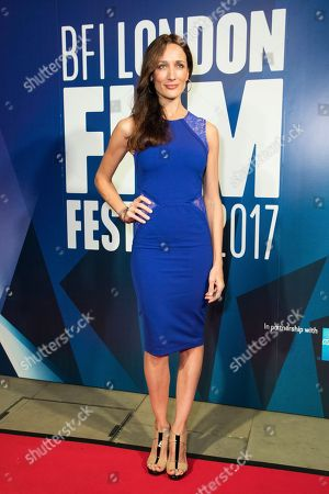 Actress Ana Asensio poses for photographers upon arrival at the London Film Festival Awards in London