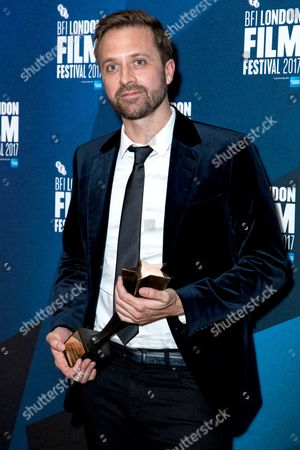 Stock Photo of Director John Trengove with the Best Feature Film award for his film 'The Wound'